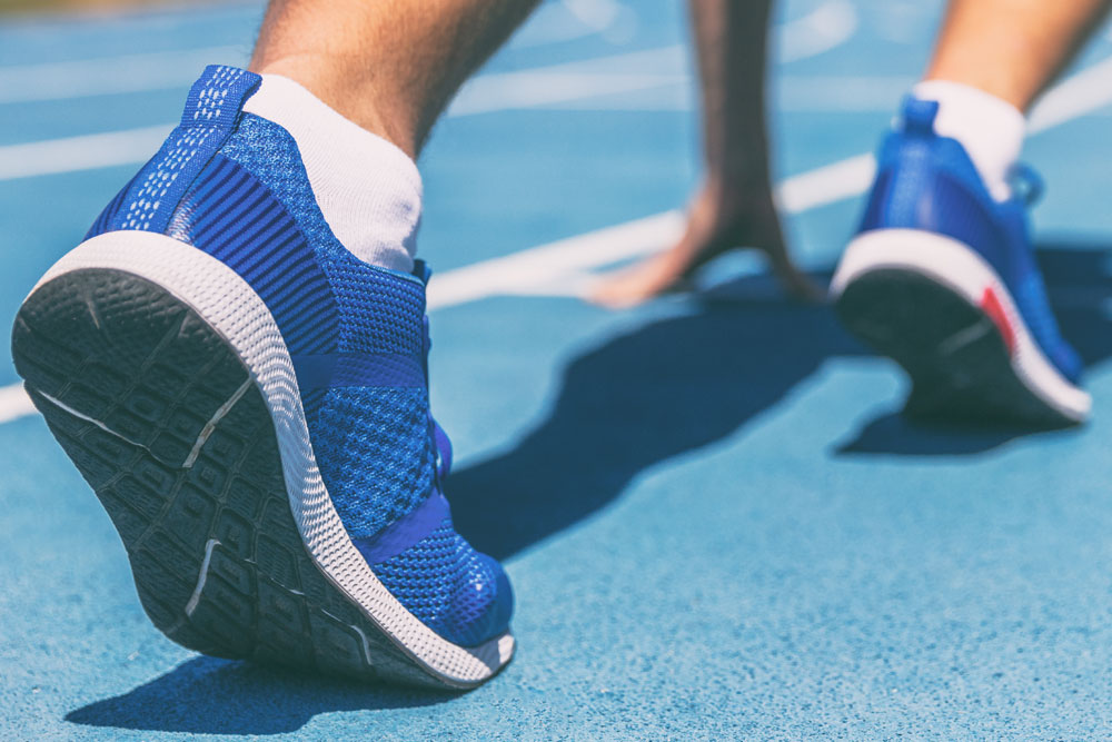 feet in the running start position allsports podiatry